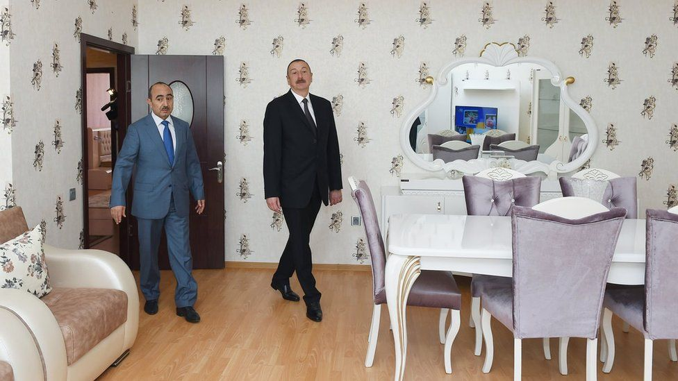 President Ilham Aliyev inspects one of the apartments