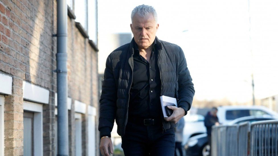 Crime reporter Peter R de Vries arrives at the heavily secured court house in Osdorp, the Netherlands