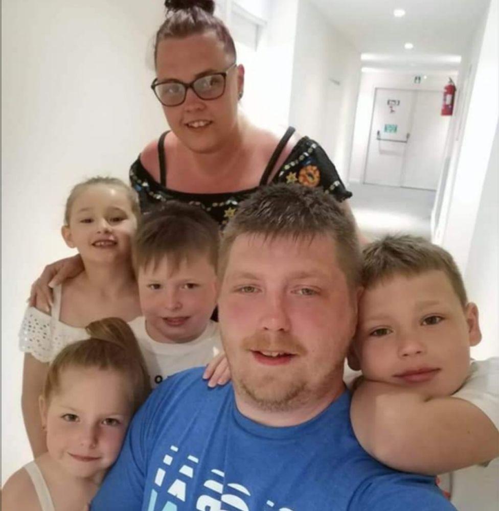 Kim Marsh with her partner and children