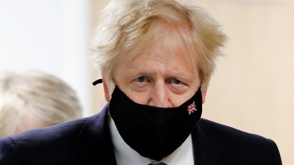 UK Prime Minister Boris Johnson wears a mask