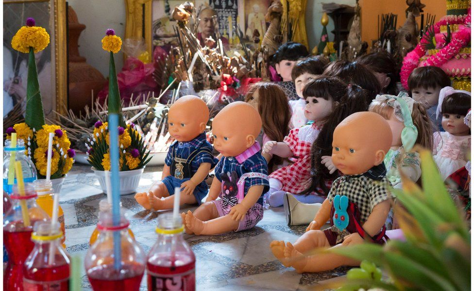Dolls sat in a room at a temple