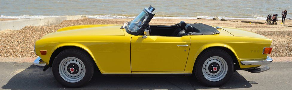 sports car on sea front