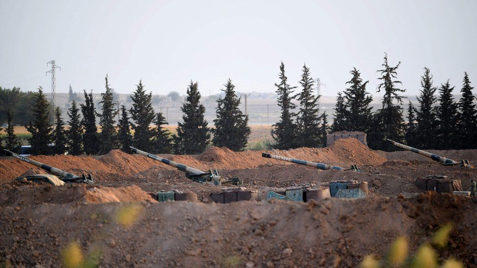 Artillery pieces on the Turkish side of the border with Syria near Akcakale in Sanliurfa province on 8 October