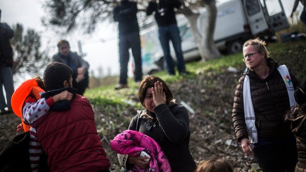 A Syrian Kurdish woman reacts after her arrival with other refugees and migrants from the Turkish coast to Mytilene, Lesbos island, Greece, Friday, Feb. 26, 2016.