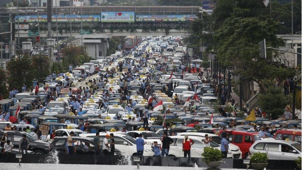 Taxis block a road in Jakarta, Indonesia (22 March 2016)