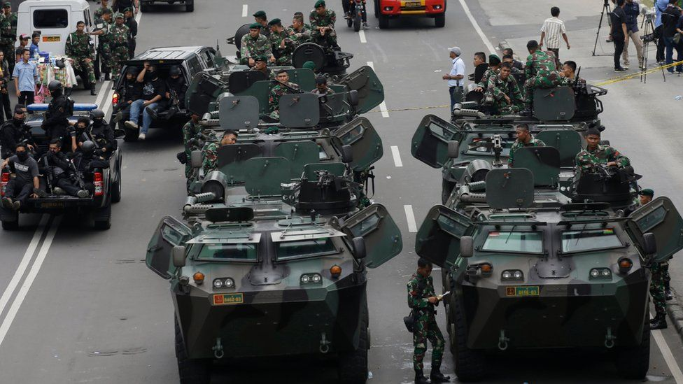 Indonesian soldiers man armoured vehicles as they guard near the site where an attack occurred in Jakarta, Indonesia Thursday, Jan. 14, 2016.