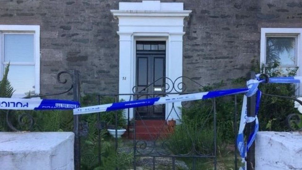 Police tape outside house