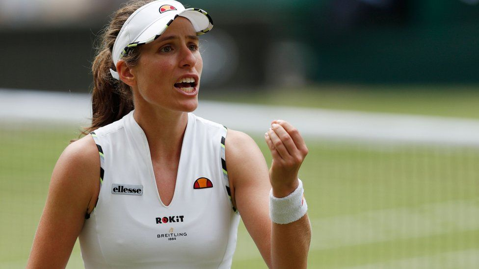 Johanna Konta reacts after hitting a shot out against Czech Republic's Barbora Strycova during their women's singles quarter-final match on day eight of the 2019 Wimbledon Championships