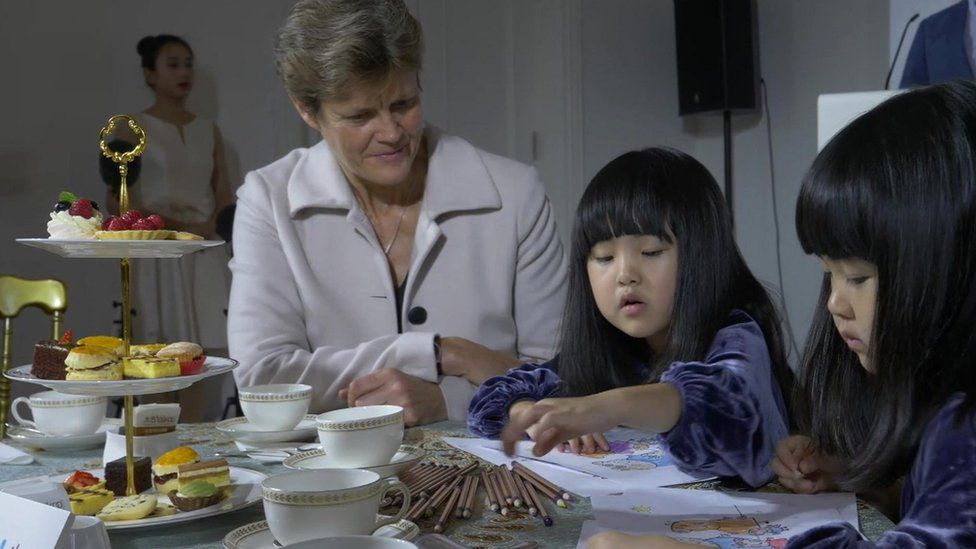 Dame Barbara Woodward, British ambassador to China, with twins Mi Ni and Mi Ai