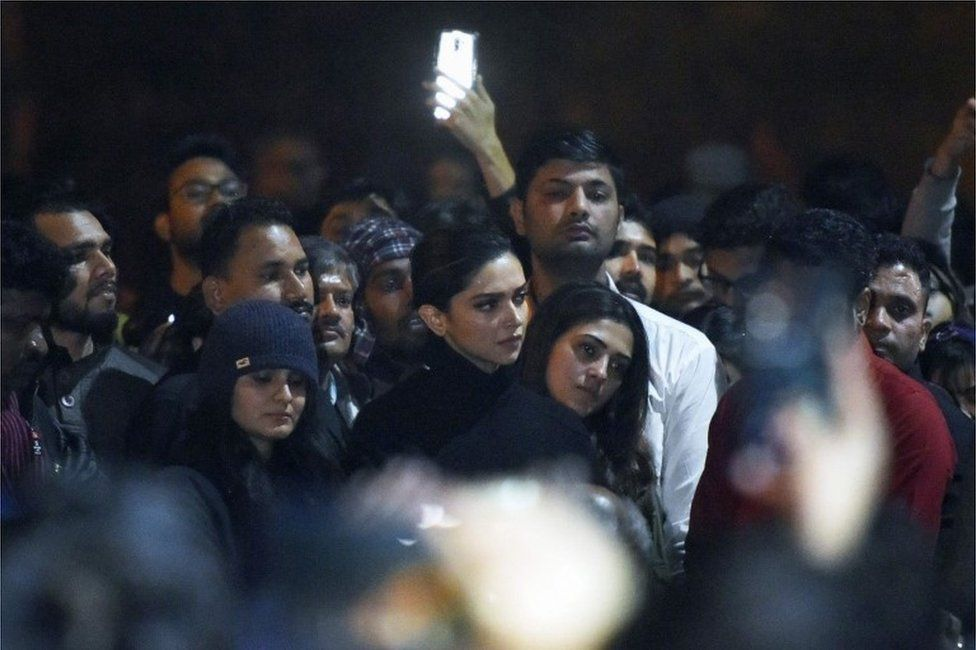 In this photo taken on January 7, 2020, Bollywood actress Deepika Padukone (C) visits students protesting at Jawaharlal Nehru University (JNU) against a recent attack at JNU on students and teachers in New Delhi