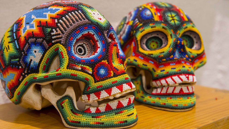 Skulls decorated with beads