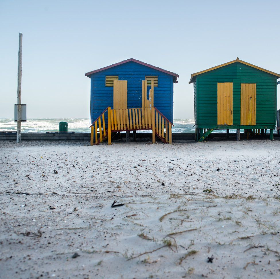 An image of beach houses next to a snow-covered beach