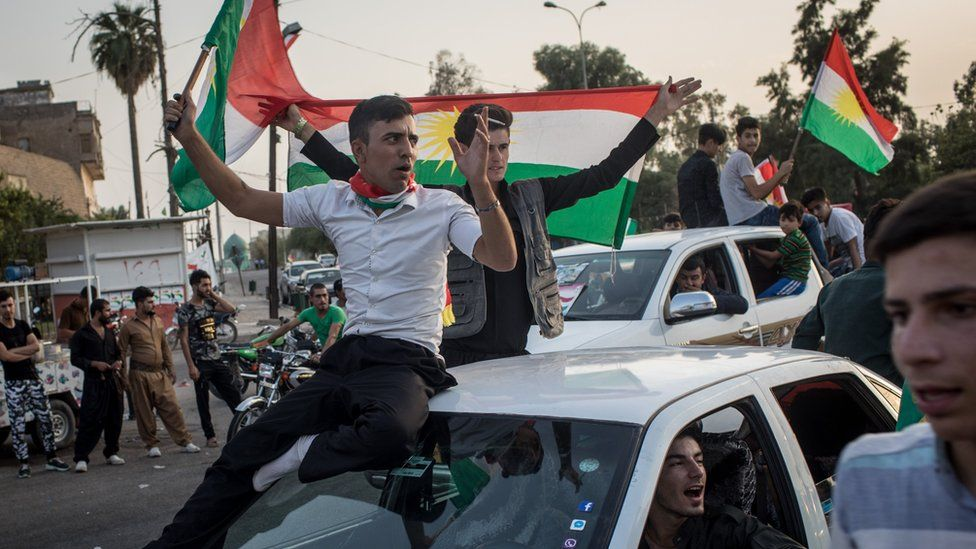Kurds celebrate on the streets after voting in an independence referendum in Kirkuk, Iraq, on 25 September 2017