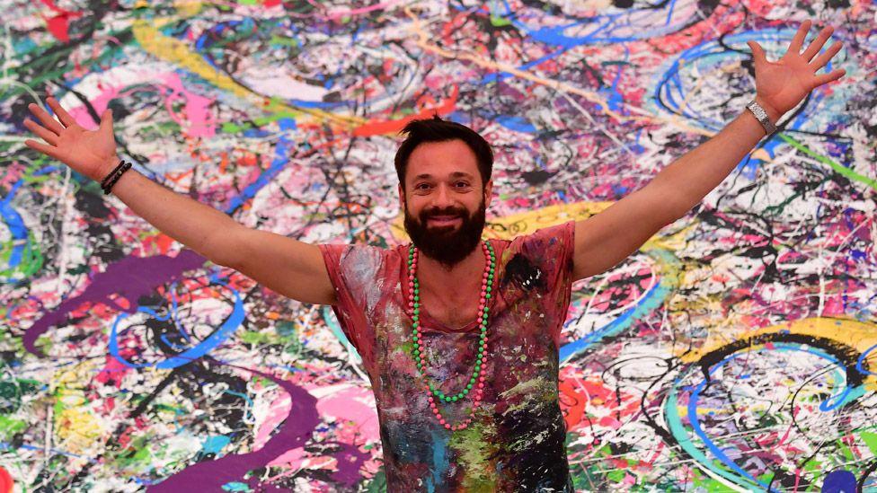 Sacha Jafri with his work The Journey of Humanity