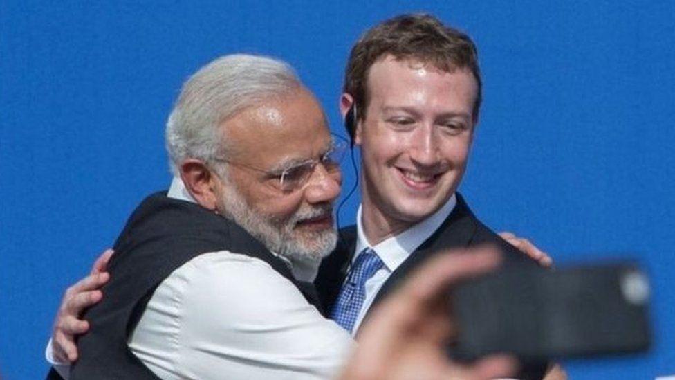 Modi hugging Mark Zuckerberg