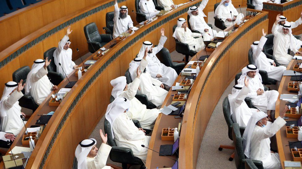 Kuwaiti MPs attend a parliament session at the National Assembly