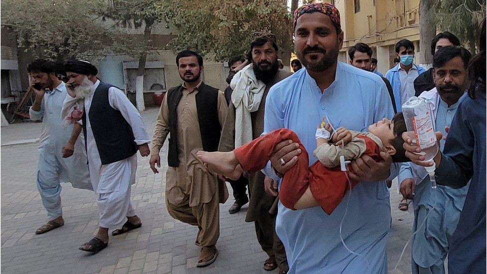 People shift an injured victim, after a 5.9 magnitude earthquake with a shallow depth of nine kilometers struck Harnai, to a hospital in Quetta, Balochistan province, Pakistan, 7 October 2021.