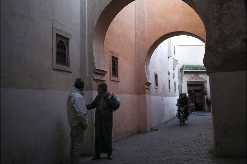 The previous day, these men were captured having a chat in an alleyway in the old city of Marrakech, Morocco.