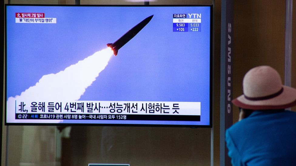 A man watches breaking news of North Korea's latest projectile launch, on a TV screen at Seoul Station in Seoul