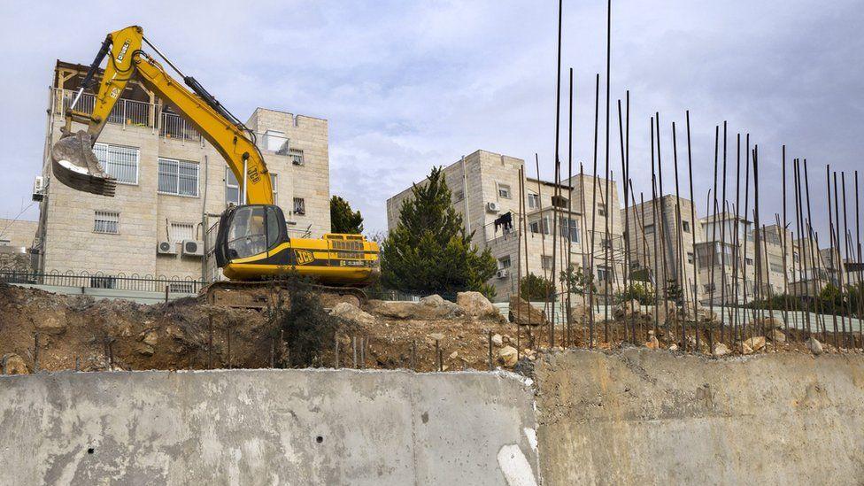 "Earth moving equipment stands in the disputed Israeli ""settlement"" of Ramat Shlomo, 23 December 2016"