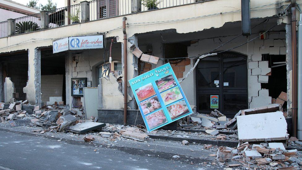Shops are seen damaged by an earthquake, measuring magnitude 4.8, at the area north of Catania