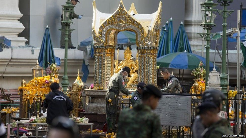 Police investigate the scene around the Erawan Shrine the morning after an explosion in Bangkok,Thailand, Tuesday, Aug. 18, 2015.
