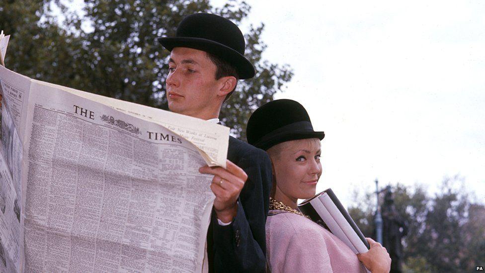 1963 fashion shoot showing man and woman wearing bowler hats