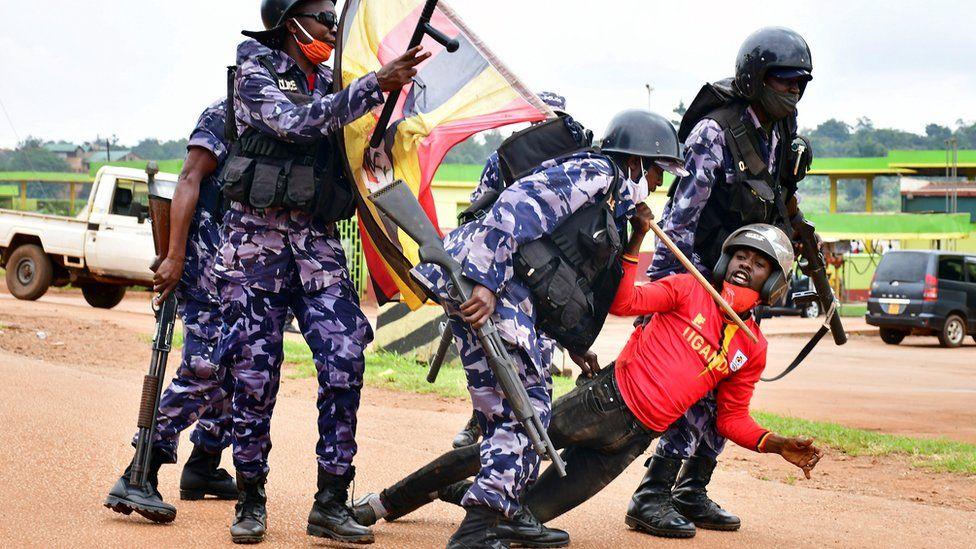 Ugandan riot police detain a supporter of presidential candidate Robert Kyagulanyi, also known as Bobi Wine, in Luuka district, eastern Uganda, 18 November 2020