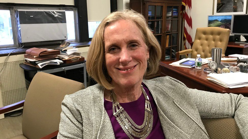 New York City Special Narcotics Prosecutor Bridget Brennan, shown in her office (she is sitting down and smiling)