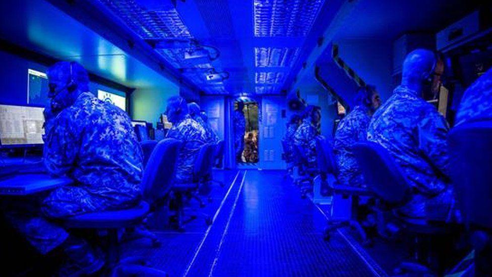 Nato officers monitoring computer screens
