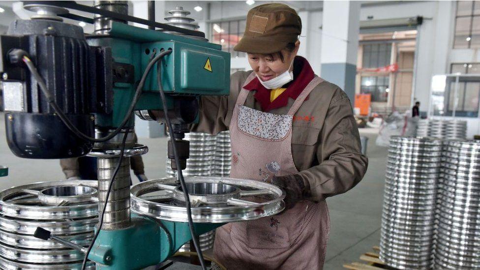 Worker in China making a bike