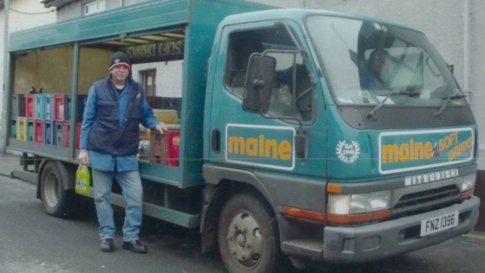 Nelson Hunter who has worked as the Maine Man standing beside his delivery van