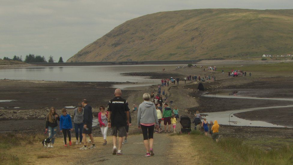 People walking along the old road at Spelga Reservoir