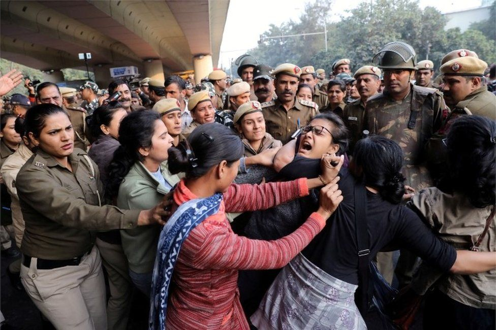 Police officers try to detain a student of Jawaharlal Nehru University (JNU) during a march to Rashtrapati Bhavan to protest against a proposed fee hike, in New Delhi, India, December 9, 2019.