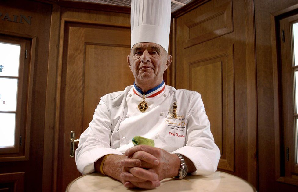 Paul Bocuse in 2007 wearing a tall chef's hat