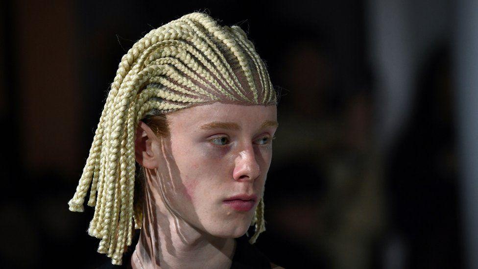 Model at the Comme Des Garcons fashion show in Paris