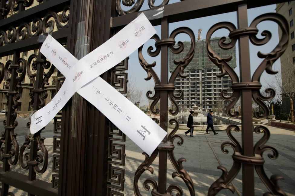 A seal is placed on the gates of a property as the government banned new property sales in counties earmarked as part of a new special economic zone in Xiongxian, Hebei province, China, 3 April 2017.