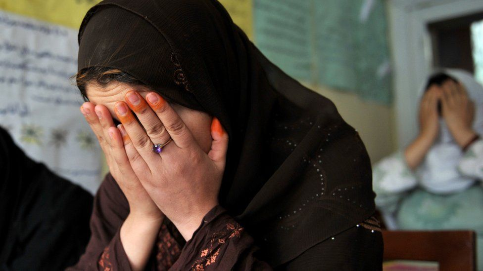 File photo: A woman poses for a portrait at a shelter for Afghan women