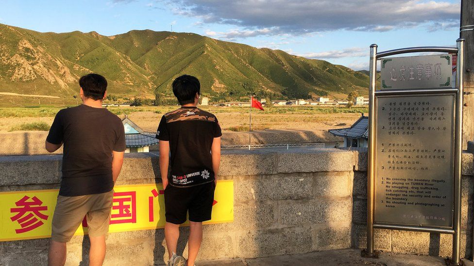 People look across to North Korea from Tumen, China. 30 Aug 2017
