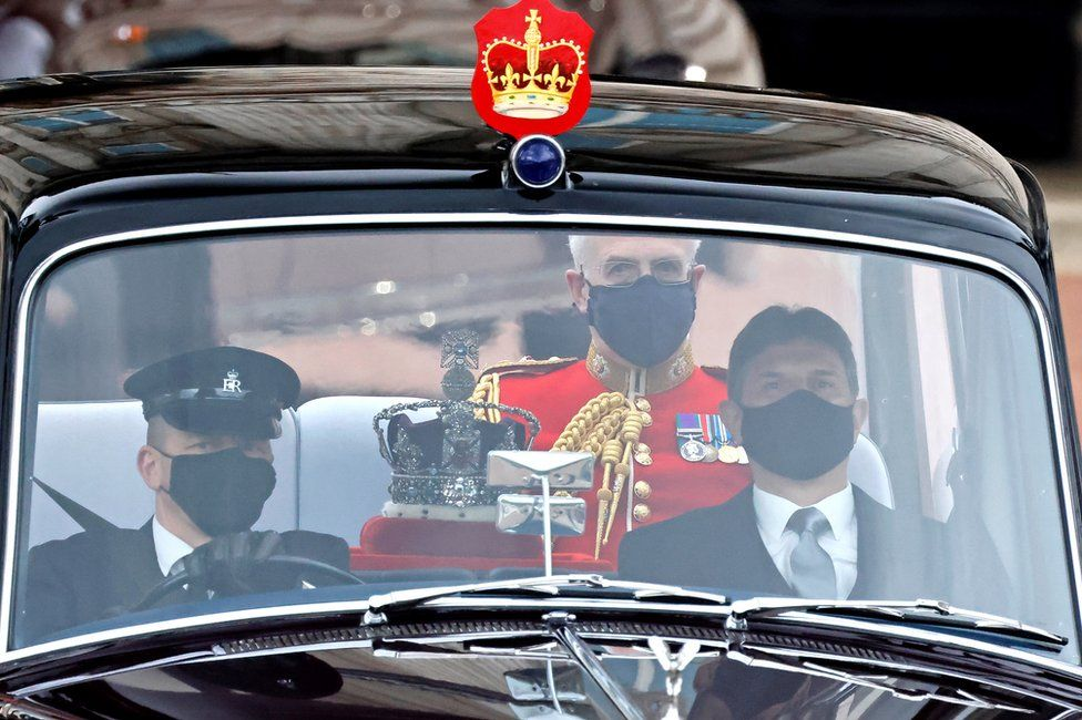 The Imperial State Crown is driven from Buckingham Palace to the Houses of Parliament for the State Opening of Parliament in London on 11 May 2021