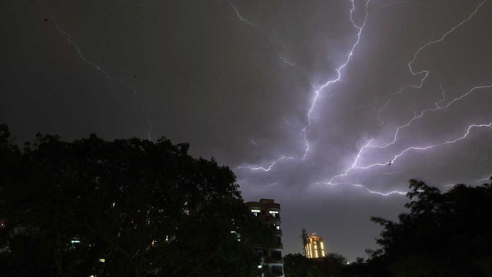 Lightning strikes over residential apartments during a thunderstorm on the outskirts of Delhi, India. Photo: 2 May 2018