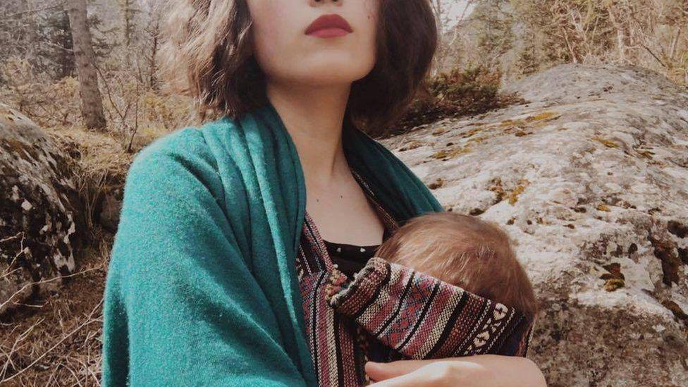 Aliya Shagieva with her baby against the backdrop of Kyrgyz landscape
