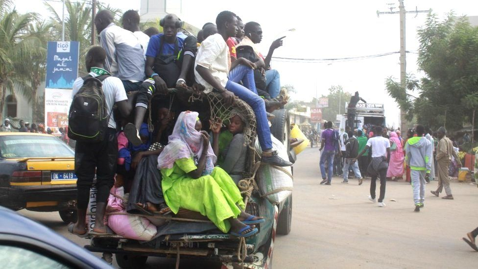 Passengers in a crowded car