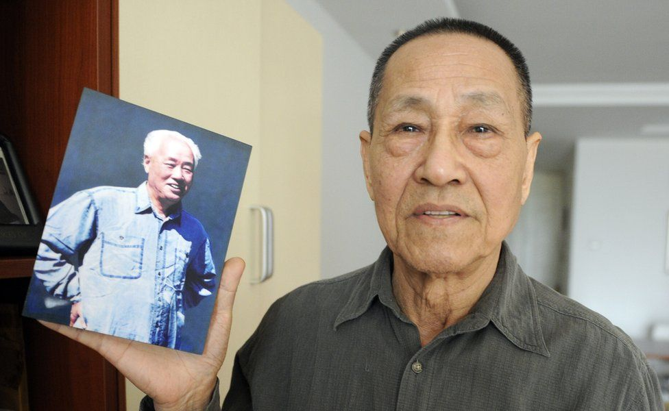 Bao Tong, a former senior government official who was jailed for opposing the 1989 Tiananmen Square crackdown, shows a photo of his former boss former Zhao Ziyang, a leading reformer and secretary-general of the Chinese Communist Party, who was toppled in 1989, after trying to find common ground with the student demonstrators in Tiananmen Square, during an interview with AFP at his home in Beijing on February 22, 2011.