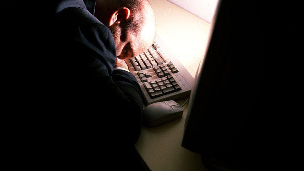 Man asleep at a computer