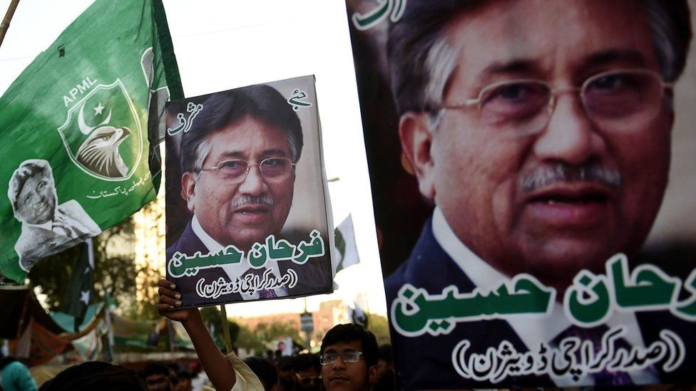 "Demonstrators carry pictures of former military ruler Pervez Musharraf, during a protest following a special court""s verdict, in Karachi on December 24, 2019."