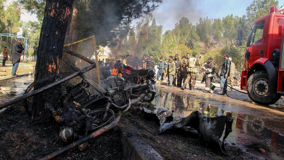 Afghan National Army (ANA) soldiers and firefighters extinguish a fire at the site of a suicide car bomb attack in Lashkar Gah in Helmand Province on February 11, 2017.