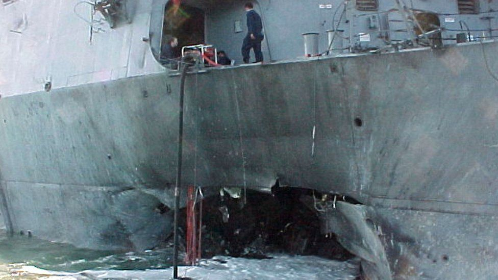 The port side of the guided missile destroyer USS Cole damaged after an attack during a refuelling operation in the port of Aden in Yemen - October 2000
