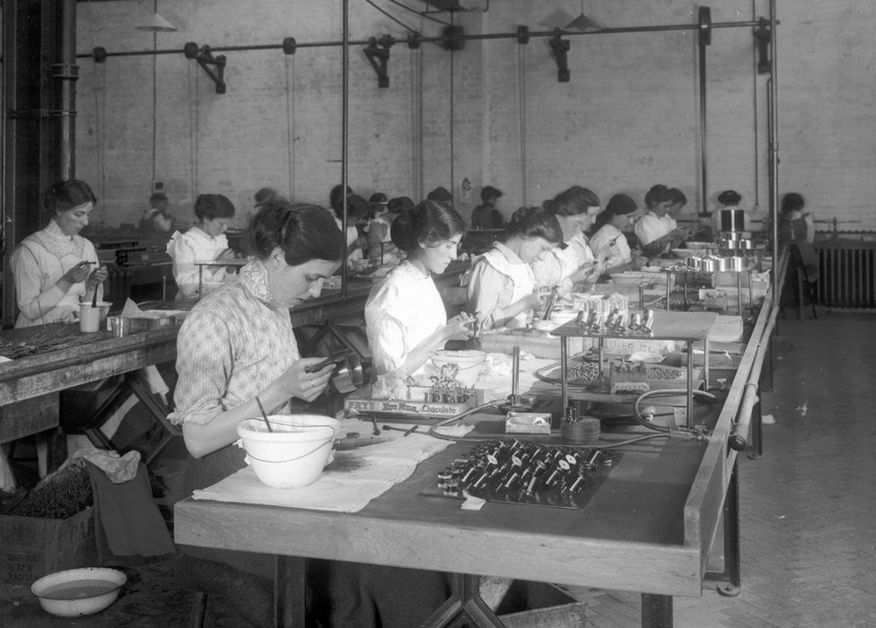 Workers assembling parts on the production line at Marconi Wireless Telegraph Works in Essex, UK in 1916