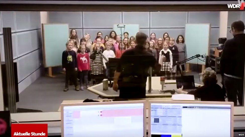 Children's choir recording in a radio studio
